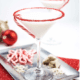 winter wonderland cocktail - martini with candy cane rim on a platter